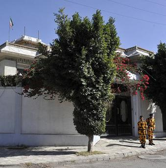 Yemeni soldiers stand guard in front of the Iranian ambassador's residence in Sanaa (AP)