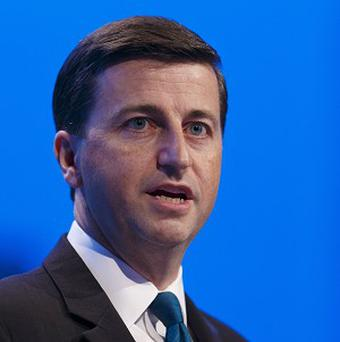 Shadow foreign secretary Douglas Alexander has urged all sides in the Syria dispute to get around the table for discussions