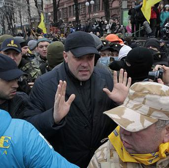 Ukrainian opposition leader Oleh Tyahnybok, centre, surrounded by pro-EU activists in Kiev (AP)