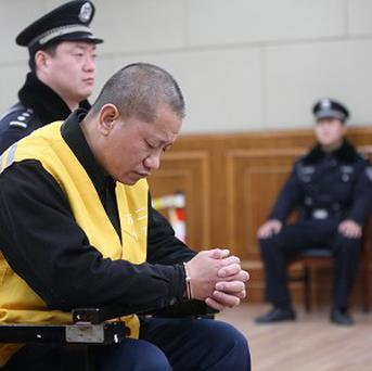 Lu Yueting during his trial in China's Hebei province where he was sentenced to life in prison for poisoning frozen dumplings (AP/Xinhua)