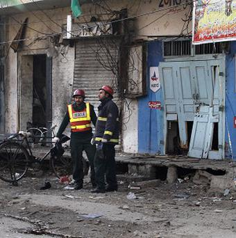 A Taliban suicide bomber blew himself up not far from Pakistan's military headquarters in the garrison city of Rawalpindi, killing nine people (AP)