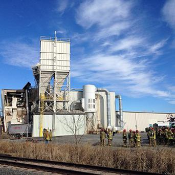 Firefighters stand outside the International Nutrition plant in Omaha, Nebraska, after a fire and explosion (AP)