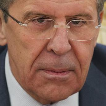 Russia's foreign minister Sergey Lavrov says rescinding Iran's invitation to peace talks over Syria is a mistake (AP)