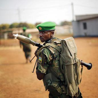 Rwandan African Union peacekeepers patrol the PK13 district of Bangui, Central African Republic (AP)