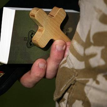 A new policy will allow US troops to seek waivers to wear religious clothing or request specific prayer times