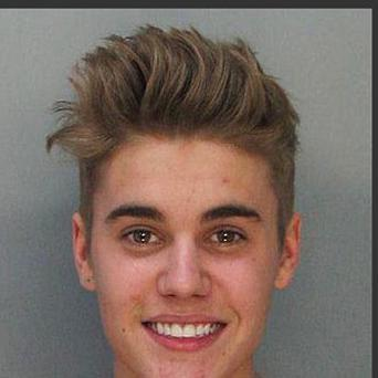 The police booking mugs made available by the Miami Dade County Corrections Department of Justin Bieber, (AP Photo/Miami Dade County Jail)