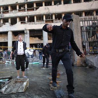 The scene outside Egyptian police headquarters in Cairo after a car bomb blast (AP)