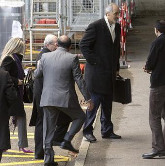 Bashar Ja'afari, centre, Syrian Ambassador to the UN, arrives with a delegation to meet mediator Lakhdar Brahimi in Geneva (AP)