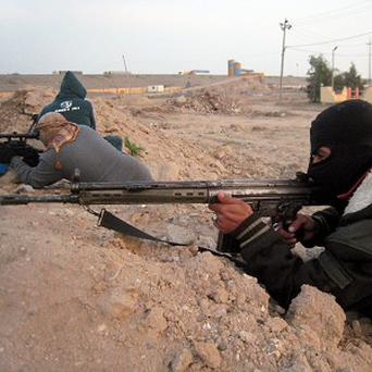 Gunmen take up combat positions in Fallujah, Iraq (AP)