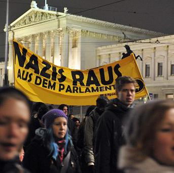 Demonstrators gather to oppose a right-wing ball being hosted at the Hofburg palace in Vienna (AP)