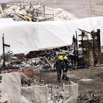 Emergency workers continue the search for victims in L'Isle-Verte, Quebec (AP/The Canadian Press, Ryan Remiorz)