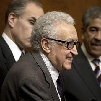 UN mediator Lakhdar Brahimi leaves a press briefing at the UN headquarters in Geneva (AP)