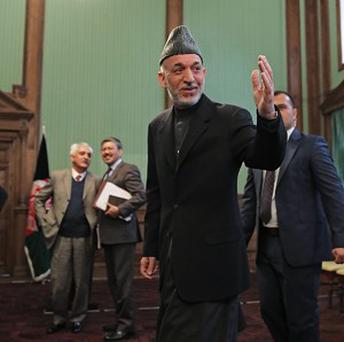 Hamid Karzai has repeatedly refused to approve the bilateral security agreement, which allows American troops to remain in Afghanistan beyond the end of this year (AP)