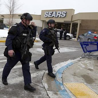 Three people died in a shooting at a mall in suburban Baltimore, including the suspected gunman (AP)