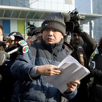Zhang Qingfang, the lawyer for jailed legal scholar and founder of the New Citizens movement Xu Zhiyong (AP)