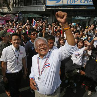 Anti-government protest leader Suthep Thaugsuban rallies supporters during a march through Bangkok (AP)