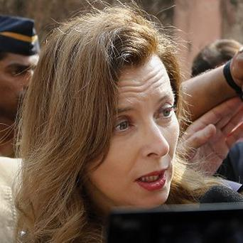 Valerie Trierweiler is surrounded by media on her visit to a hospital in Mumbai (AP)