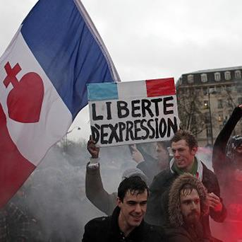 Protesters during a demonstration criticizing President Francois Hollande in Paris (AP)