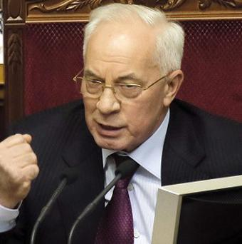 Ukraine's prime minister Mykola Azarov has offered his resignation amid protests (AP)