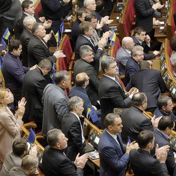 Ukrainian MPs have passed an amnesty measure for arrested protesters (AP)