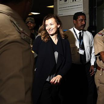 Valerie Trierweiler smiles as she arrives to board a flight in Mumbai, India (AP)