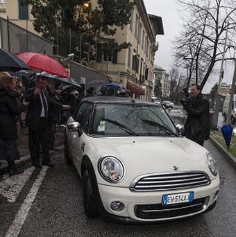 Amanda Knox co-defendant Raffaele Sollecito, driving the car, leaves the Udine police station (AP)