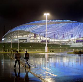 The Bolshoy Ice Dome is lit up at night in the Olympic Park in Sochi. (AP)