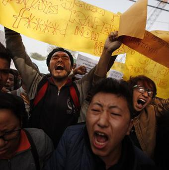 Students from north eastern states of India shout slogans during a protest in New Delhi (AP)