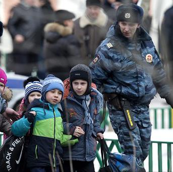 Police officers evacuate children from the Moscow school (AP Photo/Alexander Zemlianichenko)