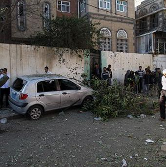 People gather at the site of a small explosion in Sanaa, Yemen, on the same day a British national working with an oil services company was abducted in the city (AP)