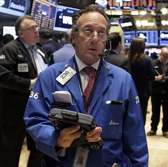 Trader Steven Kaplan works on the floor of the New York Stock Exchange (AP)