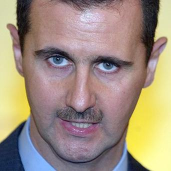 Bashar Assad's government has not decided whether to take part in a second round of Syria peace talks, an adviser says