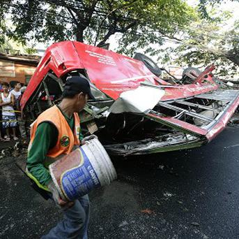 A passenger bus plunged from an elevated highway known as the Skyway in Paranaque in the Philippines (AP)
