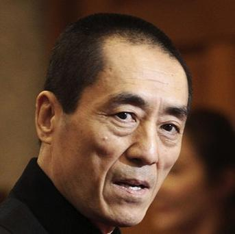Chinese film director Zhang Yimou and his wife have paid more than 1.2 million US dollars in fines for having three children (AP)