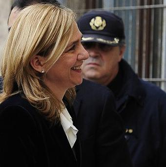 Spain's Princess Cristina leaves her car upon arrival at the courthouse in Palma de Mallorca (AP)