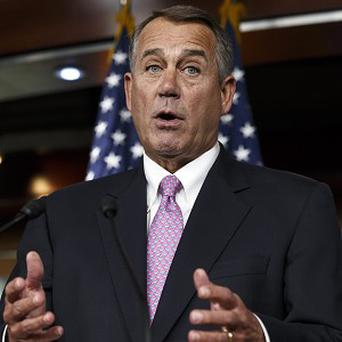 House of Representatives speaker John Boehner relented over the US government's borrowing cap (AP)