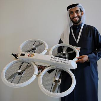 Emirati consultant Abdulrahman Mansour Al Serkal presents a drone prototype as part of an initiative by the prime minister's office during the Dubai Government Summit (AP)