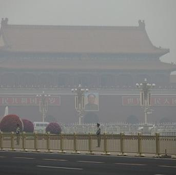 Tiananmen Square on a polluted day in Beijing as China's cabinet announced a new fund to reward cities and regions that make significant progress in controlling air pollution (AP)
