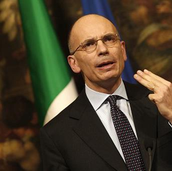 Italian Premier Enrico Letta is trying to hold on to power
