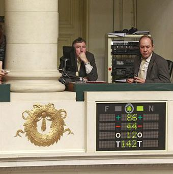Journalists look at the electronic voting board as Belgian MP vote in favour of the bill on child euthanasia at the parliament in Brussels (AP)
