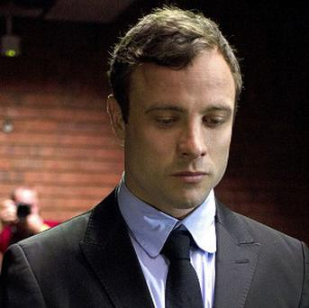 Oscar Pistorius says he is consumed by grief on the first anniversary of the day that he fatally shot his girlfriend (AP)