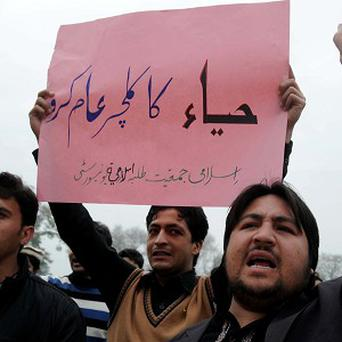 "Students rally against Valentine's Day holding a placard that reads ""spread the culture of modesty,"" in Peshawar (AP)"