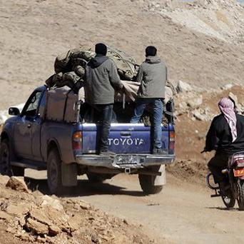 Syrians flee Yabroud, the last rebel stronghold in the mountainous Qalamoun region (AP)