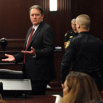 Michael Dunn reacts after the verdict is read convicting him of attempted murder in the shooting death of a teenager over an argument over loud music (AP/Florida Times-Union)