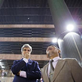 US Secretary of State John Kerry, left, tours the Istiqlal Mosque with Grand Imam KH Ali Mustafa Yaqub (AP)