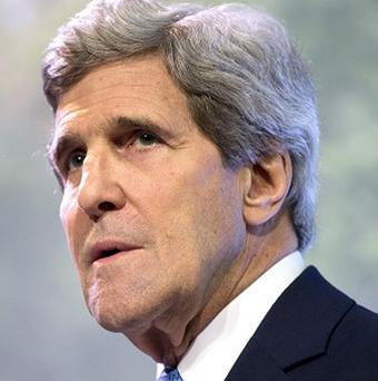 US secretary of state John Kerry has condemned Syria's 'barbaric assault on its civilian population' amid peace talks in Geneva (AP)