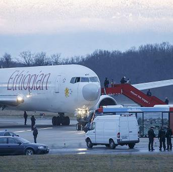 Passengers are evacuated from a hijacked Ethiopian Airlines Plane on the airport in Geneva, Switzerland (AP)