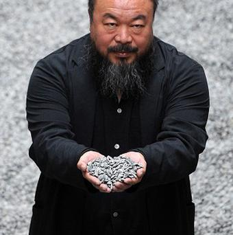A man has been charged with criminal mischief after smashing a vase by Ai Weiwei, pictured, the Perez Art Museum in Miami