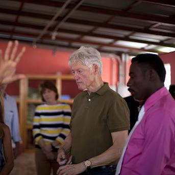 Bill Clinton visits the Union Des Apotres Prodev School in Port-au-Prince, Haiti (AP)
