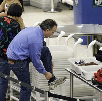 Air passengers in the US have had to take their shoes off at airport security since 2001 (AP)